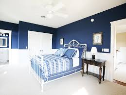 bedroom bedside table blue bedroom ceiling fan closet dark walls