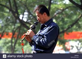 Flute Flag A Chinese Man Playing A Traditional Hulu Si Flute Kind Of