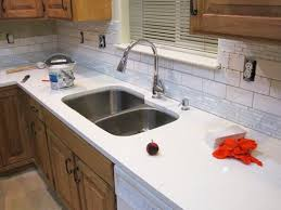 How To Install A Mosaic Tile Backsplash In The Kitchen Installing A Mosaic And Subway Tile Kitchen Backsplash
