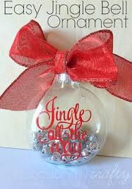 rolled up scrapbook paper inside clear ornaments