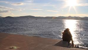zadar dec 10 2014 man sitting and thinking by sea organ in