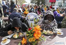skid row residents homeless served thanksgiving dinners in