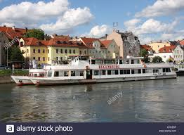 the regensburg river cruise boat moored on the danube river at