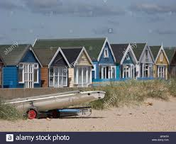 beach huts and boat at the seaside on mudeford sandspit