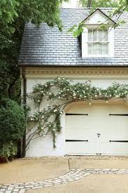 pergola to garage with vines thayer u0026 reed