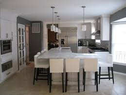 kitchen with l shaped island marble countertops l shaped kitchen island lighting flooring