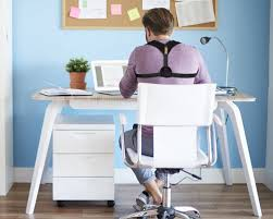 Sitting On A Medicine Ball At Desk 4 Products That Help You Improve Your Posture While You Work
