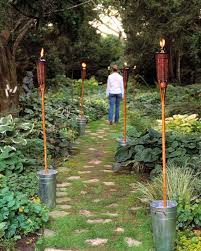 diy outdoor lighting without electricity tiki torch anchors use this anchoring trick to get the romantic glow