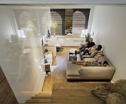 apartment attractive seats in front of bookshelves at small apartment pleasing small apartment ideas with chaise and white lacquer finish furniture and wooden stair