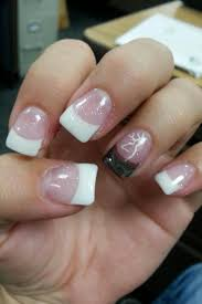 classy white tips and a camo accent nail with the browning symbol