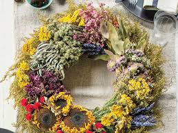 fall wreath with dried flowers and herbs southern living