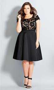 a halter neck top in dark hues and thick fabric will help you to