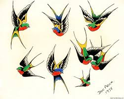flying birds tattoo designs flying swallow birds tattoo design photos pictures and sketches
