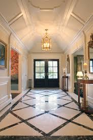 elegant paneled entrance with custom designed marble floor