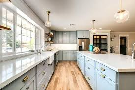 kitchen cabinets with cup pulls kitchen cabinet cup pulls hardware blue shaker cabinets with gold