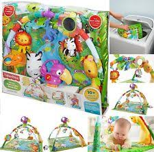 fisher price rainforest music and lights deluxe gym playset mzsfaaaqvr cy4tjgehtdnq jpg
