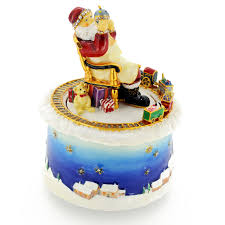 red christmas santa claus with train moving around music box
