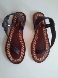 carved one strap sandals dark brown