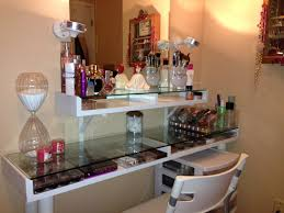 white vanity table with clear glass top for displaying makeup