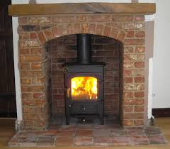Wood Burning Fireplace by Clearview Pioneer Wood Burning Stove With Brick Arch And Beam