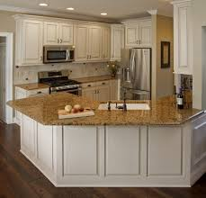 pictures of white kitchen cabinets with granite countertops kitchen pretty white kitchen cabinets with brown granite