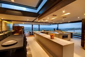 kitchen island dining table glass walls views luxurious modern