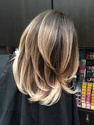 medium lentgh hair with highlights and low lights guy tang blonde balayage west hollywood ca united states