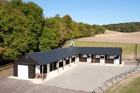 find out more about this l shaped equestrian building in