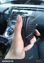 police female officer using walkietalkie twoway stock photo