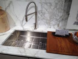 kitchen sink integrated cutting board ideas with white granite top franke peak sink shown with cutting board and bottom grid and new pull down faucet in chrome on display in birch showroom chicago il