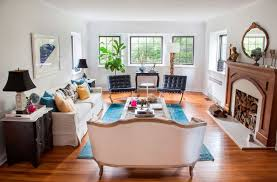 living room with sofas and barcelona chairs the stylish