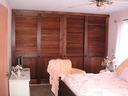bedroom milky glass sliding door with black wooden frame on brown