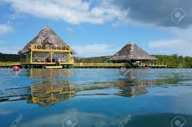 from water surface tropical bungalow and restaurant on stilts