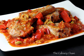 calabrian cuisine chops calabria style with tomatoes peppers and olives the