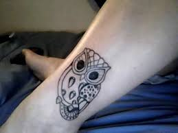 simple designed black ink little owl tattoo on leg tattoos photos