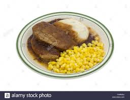 cuisine tv plus a microwaved meatloaf with gravy plus mashed potatoes and corn tv
