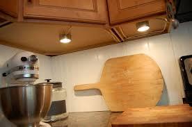kitchen under cabinet lighting design with tile backsplash ideas