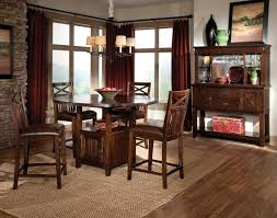 brown rug under rounded glass top dining table combined with