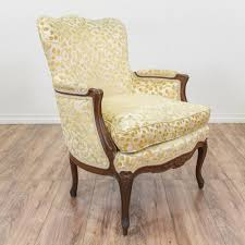 this bergere chair is upholstered in a durable off cream