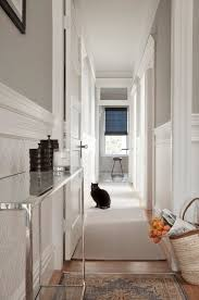 long and narrow hallway features upper walls painted gray and