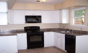 kitchen designs with white cabinets and black appliances kitchen