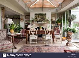 roundback wooden dining chairs around antique farmhouse table in roundback wooden dining chairs around antique farmhouse table in dining room with antique persian carpets and