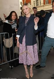 kirsten dunst dazzles in a flirty floral midi dress and navy