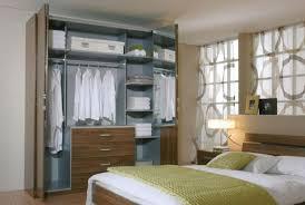 armoire pour chambre à coucher les portes de placard pliantes pour un rangement joli et moderne