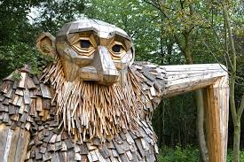 friendly giants built from recycled wood hidden in the forests of