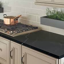 white kitchen cabinets with black quartz the side black quartz and black granite countertops