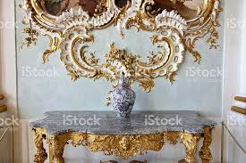 baroque vase on rococo table with golden ornament in backgrlound