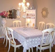 lovely shabby chic dining room with a wall mirror and chandelier