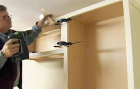 Installing Base Cabinets On Uneven Floor How To Install Kitchen Cabinets This Old House