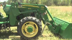 removing and re attaching john deere 553 loader youtube